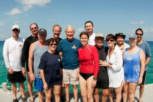 Donna in Red on Grand Cayman with astronaut Charlie Duke.